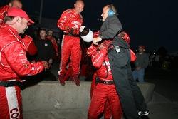 Chip Ganassi crew members celebrate victory