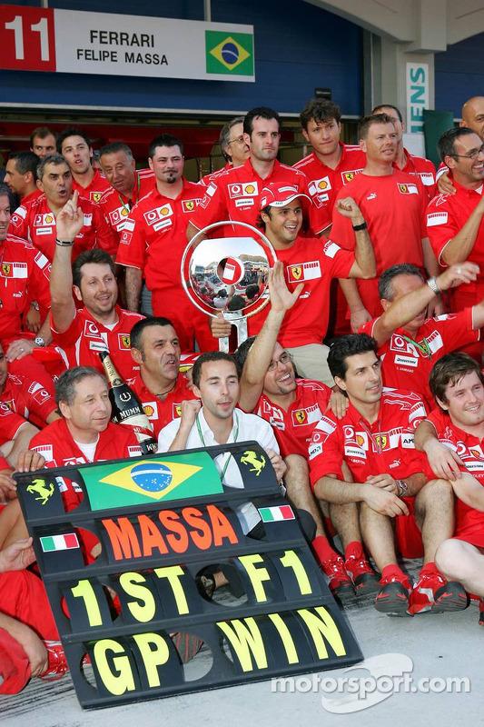Race winner Felipe Massa celebrates with Jean Todt, Nicolas Todt, Michael Schumacher and Scuderia Fe