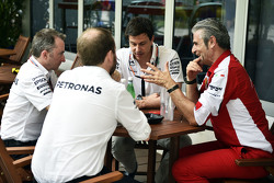 (L to R): Paddy Lowe, Mercedes AMG F1 Executive Director, with Toto Wolff, Mercedes AMG F1 Shareholder and Executive Director and Maurizio Arrivabene, Ferrari Team Principal