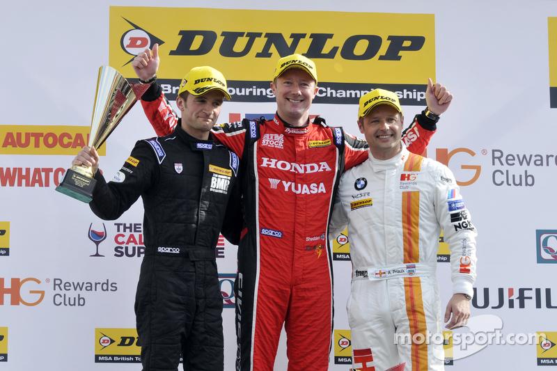 Podium: race winner Gordon Shedden, second place Andy Priaulx, third place Colin Turkington