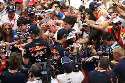 (L to R): Daniil Kvyat, Red Bull Racing and Daniel Ricciardo, Red Bull Racing sign autographs for the fans