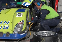 Tire change for #75 Krohn Racing Ford Riley: Tracy Krohn, Boris Said, Max Papis, Jorg Bergmeister