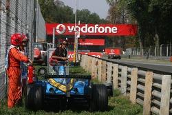 Fernando Alonso retires with engine failure
