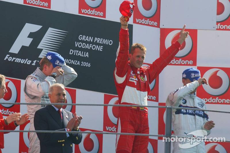 Podium: race winner Michael Schumacher with Kimi Raikkonen and Robert Kubica