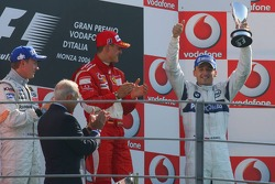 Podium: race winner Michael Schumacher with Kimi Raikkonen and Robert Kubica