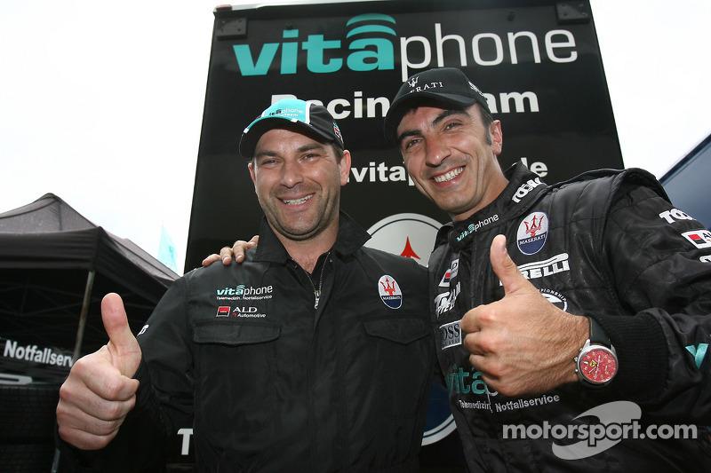 Pole winners Michael Bartels and Andrea Bertolini celebrate