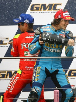 Podium: champagne for Marco Melandri and Chris Vermeulen