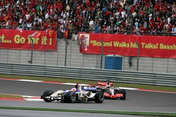 Rubens Barrichello leads Pedro de la Rosa