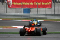 Christijan Albers spins and is passed by Giancarlo Fisichella