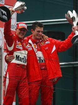 Podium: race winner Michael Schumacher celebrates with Chris Dyer