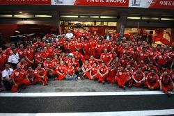 Race winner Michael Schumacher celebrates with Ferrari team members