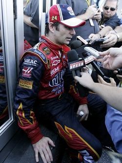 Jeff Gordon responds to question from the media after falling out of the race with engine problems