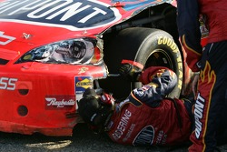 Dupont Chevy crew members work on the car of Jeff Gordon