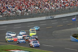 Brian Vickers leads the second group of cars on pit road