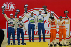 Podium: winners Marcus Gronholm and Timo Rautiainen with second place Mikko Hirvonen and Jarmo Lehtinen with third place Henning Solberg and Cato Menkerud