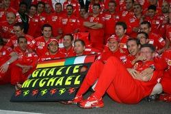Michael Schumacher celebrates his retirement with Ferrari team members