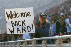 A fan holds a sign for Ward Burton