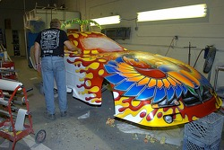 Chuck Buckler checking a section of paint