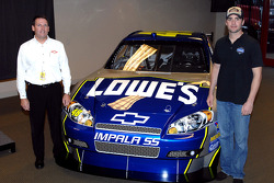 Press conference: NASCAR Program Manager for General Motors Racing Pat Suhy and Jimmie Johnson pose with the Chevy Impala SS Car of Tomorrow