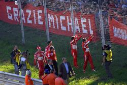 Marc Gene, Luca Badoer, Michael Schumacher and Felipe Massa wave to the crowd