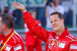 Michael Schumacher waves to the crowd