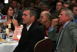 Christie, Bob, Terry and Bobby Labonte watch the auction of Terry's driving suit