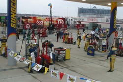 Refuling fuel cans during the race