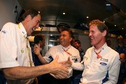 M-Sport boss Malcolm Wilson is congratulated by Phil Short and Jost Capito as Ford become the 2006 World Rally Manufacturers Champions