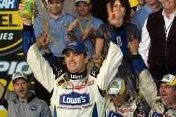 Championship victory lane: 2006 NASCAR Nextel Cup champion Jimmie Johnson celebrates