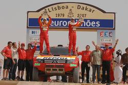 Car category podium: Stéphane Peterhansel and Jean-Paul Cottret celebrate