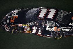 Denny Hamlin in his wrecked car