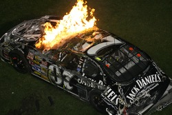 Last lap crash: the car of Clint Bowyer on fire