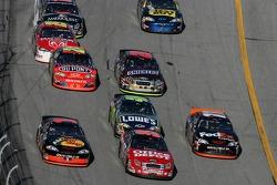 Martin Truex Jr., Carl Edwards and Denny Hamlin lead a group of cars