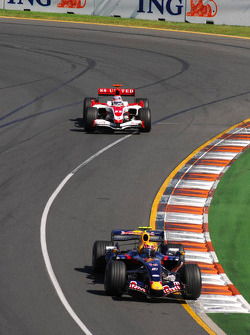 Mark Webber, Red Bull Racing, RB3 and Takuma Sato, Super Aguri F1, SA07