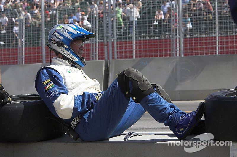 A crew member relaxes between pitstops