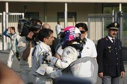 Race winner Marc Gene celebrates with Pedro Lamy