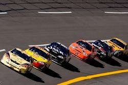 Dale Jarrett leads a group of cars