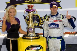 Victory lane: race winner Jimmie Johnson celebrates with a  lovely representative from Crown Royal
