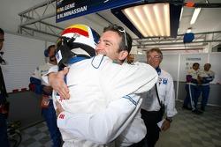 Pole winner Marc Gene celebrates with Nicolas Minassian
