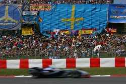 A car passes in front of the crowd of Spanish fans