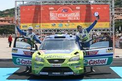 Podium: rally winners Marcus Gronholm and Timo Rautianen celebrate