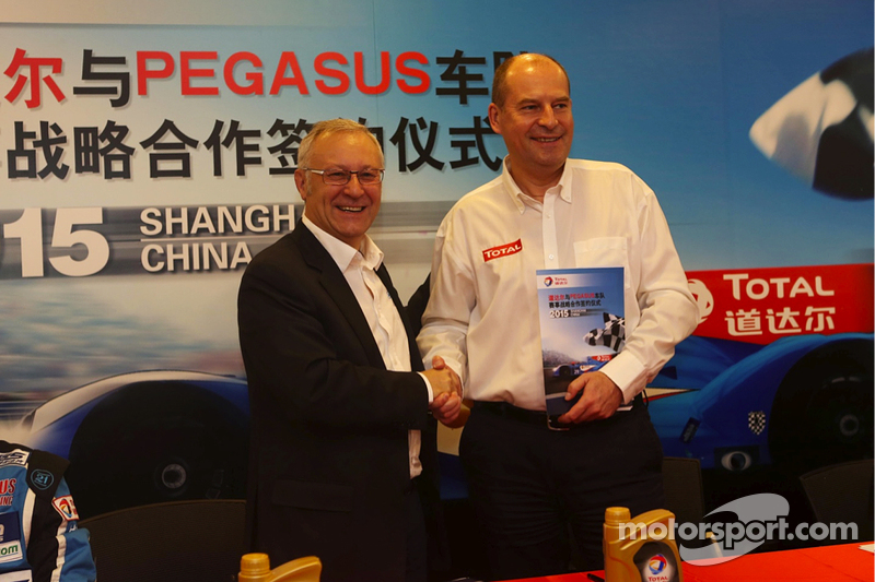 Remy Brouard, Pegasus Racing sports marketing manager and Patrice Devemy, managing director of Total