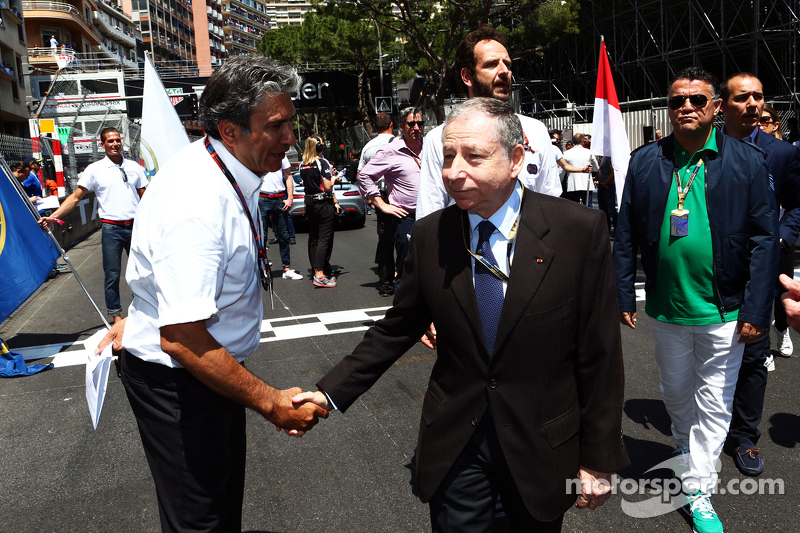 (L to R): Pasquale Lattuneddu, of the FOM with Jean Todt, FIA President on the grid