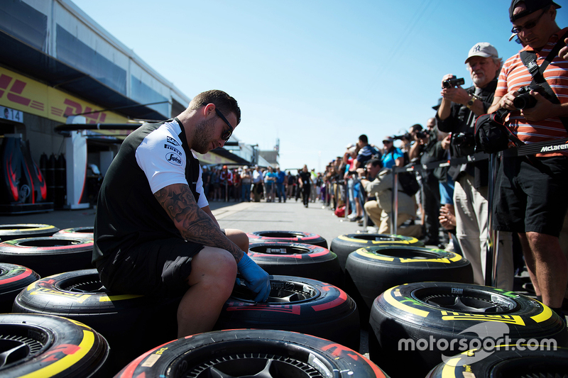 Pirelli tyres worked on by a McLaren mechanic