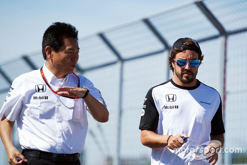 Yasuhisa Arai, Honda Motorsport Chief Officer walks the circuit with Fernando Alonso, McLaren