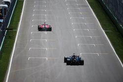 Kimi Raikkonen, Ferrari SF15-T leads Pastor Maldonado, Lotus F1 E23