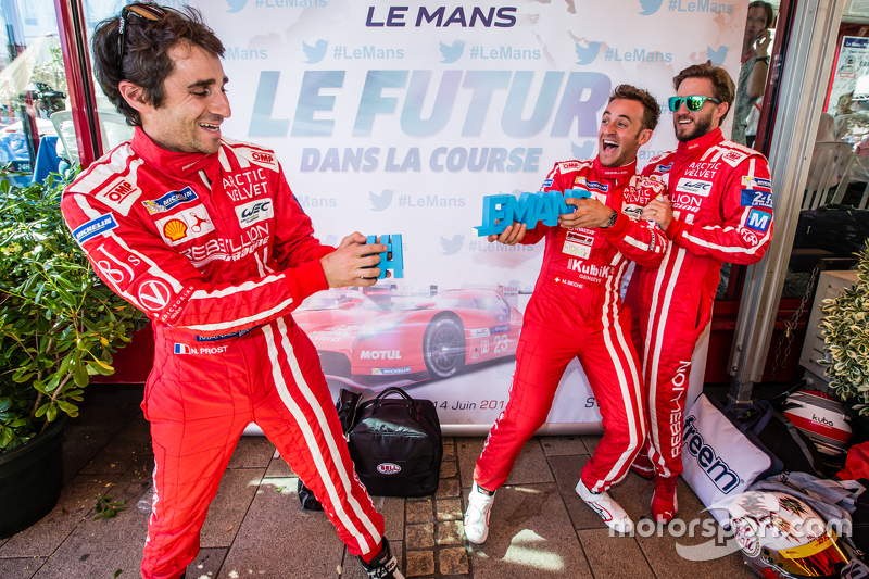 Rebellion Racing: Nicolas Prost and Mathias Beche break the #LEMANS sign while Nick Heidfeld looks o