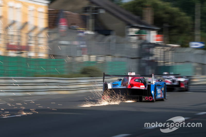 Sparks fly behind the #21 Nissan Motorsports Nissan GT-R LM NISMO: Tsugio Matsuda, Lucas Ordonez, Mark Shulzhitskiy