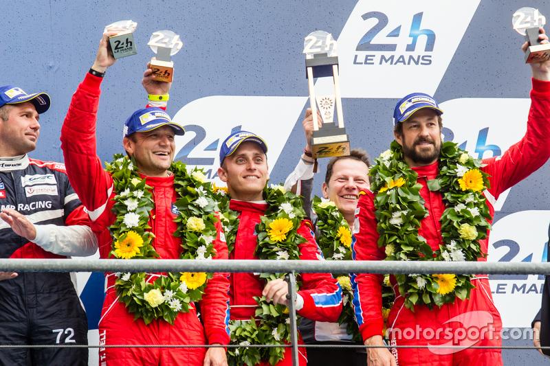 LMGT Am podium: third place #62 Scuderia Corsa Ferrari 458 GTE: Bill Sweedler, Townsend Bell, Jeff S