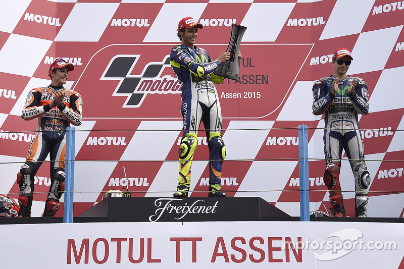 Podium: race winner Valentino Rossi, second place Marc Marquez, third place Jorge Lorenzo